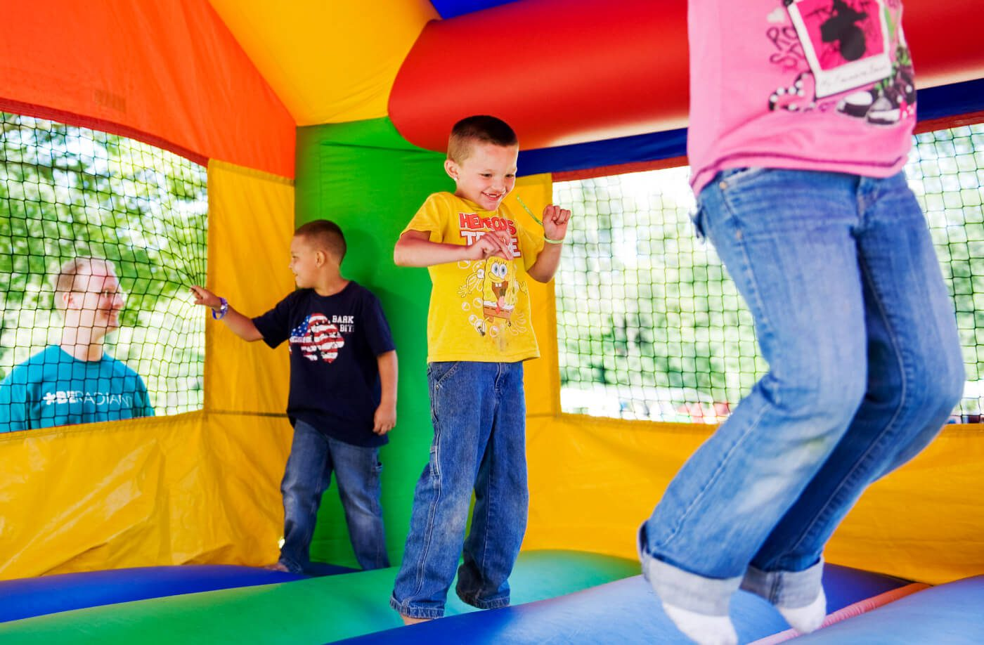 children jumping in a bounce house rental