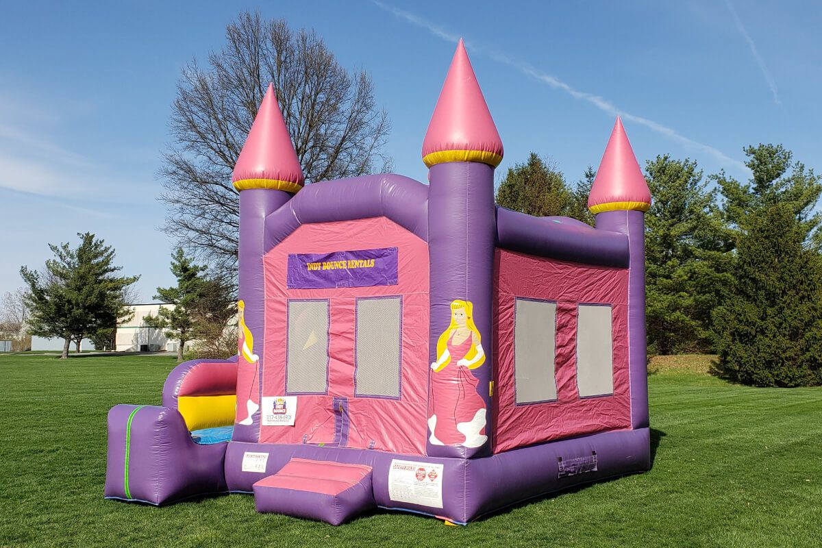 princess bounce house with slide set up in indianapolis park