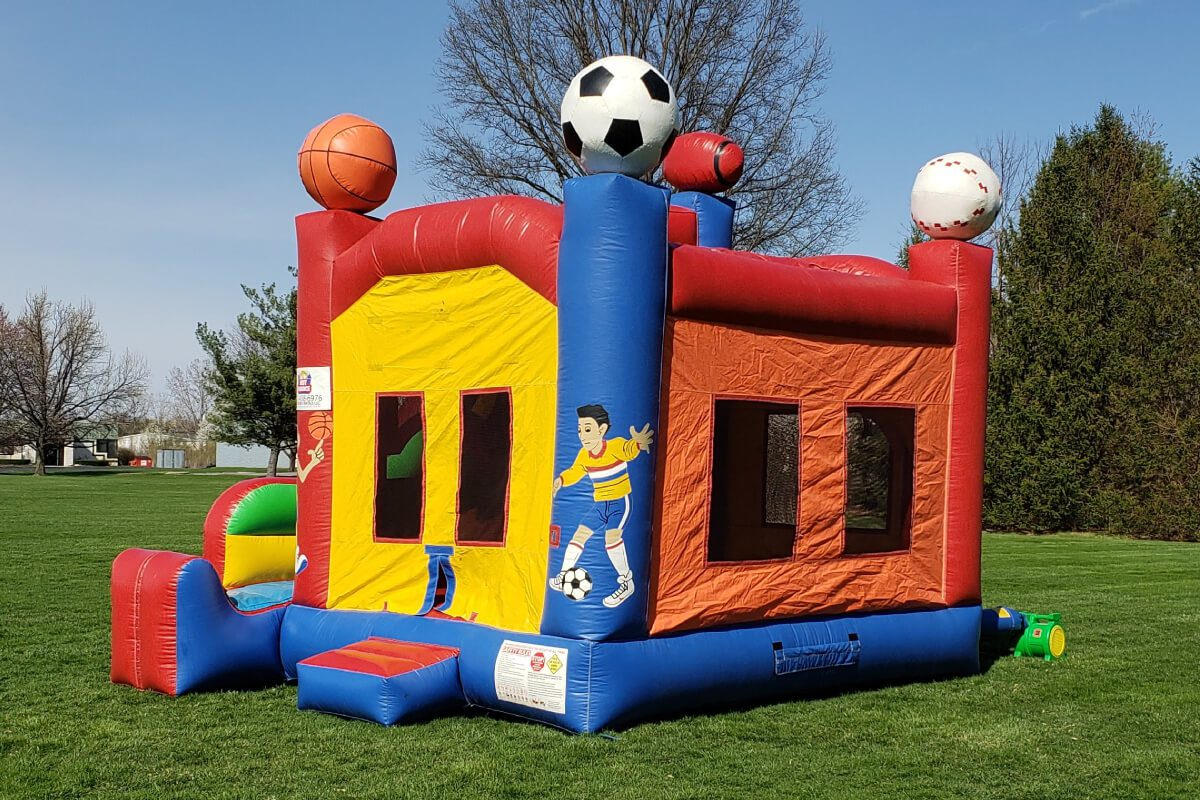 basic bounce house with slide set up in indianapolis park