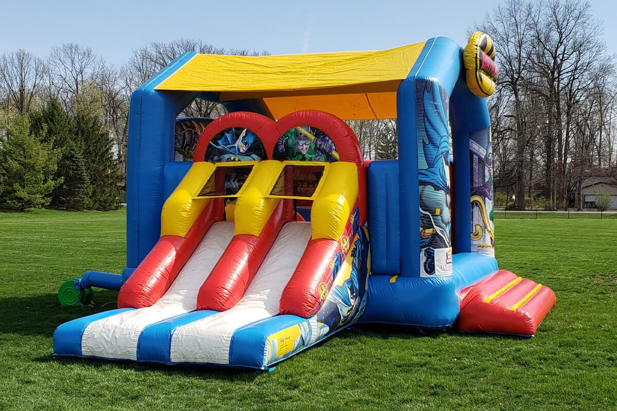 batman bounce house with slide set up in indianapolis park