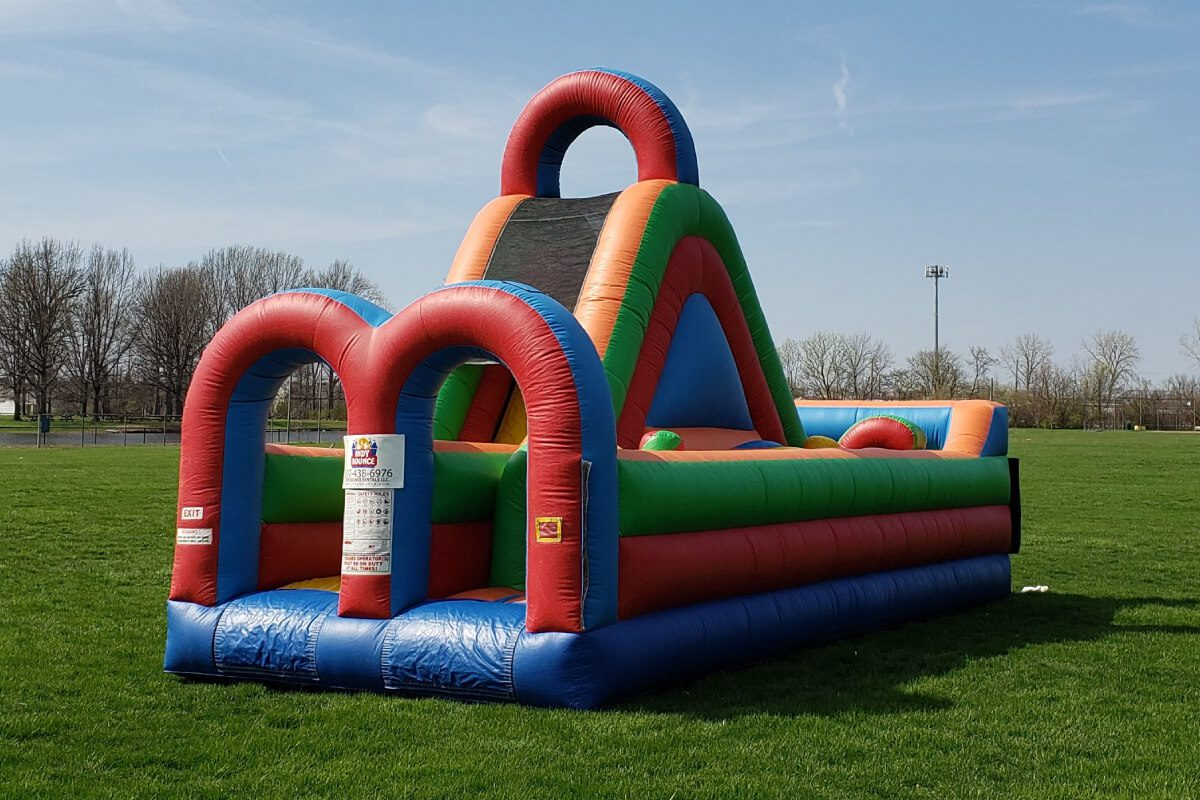 colorful obstacle course bounce house set up in indianapolis park
