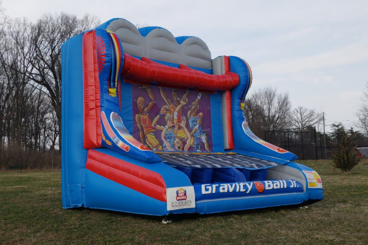 interactive game bounce house set up in an indianapolis park