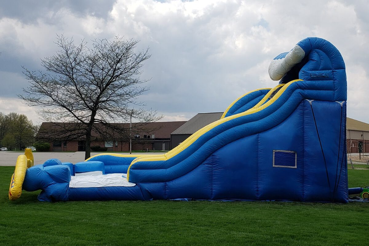 wave splash bounce house with water slide set up in indianapolis park