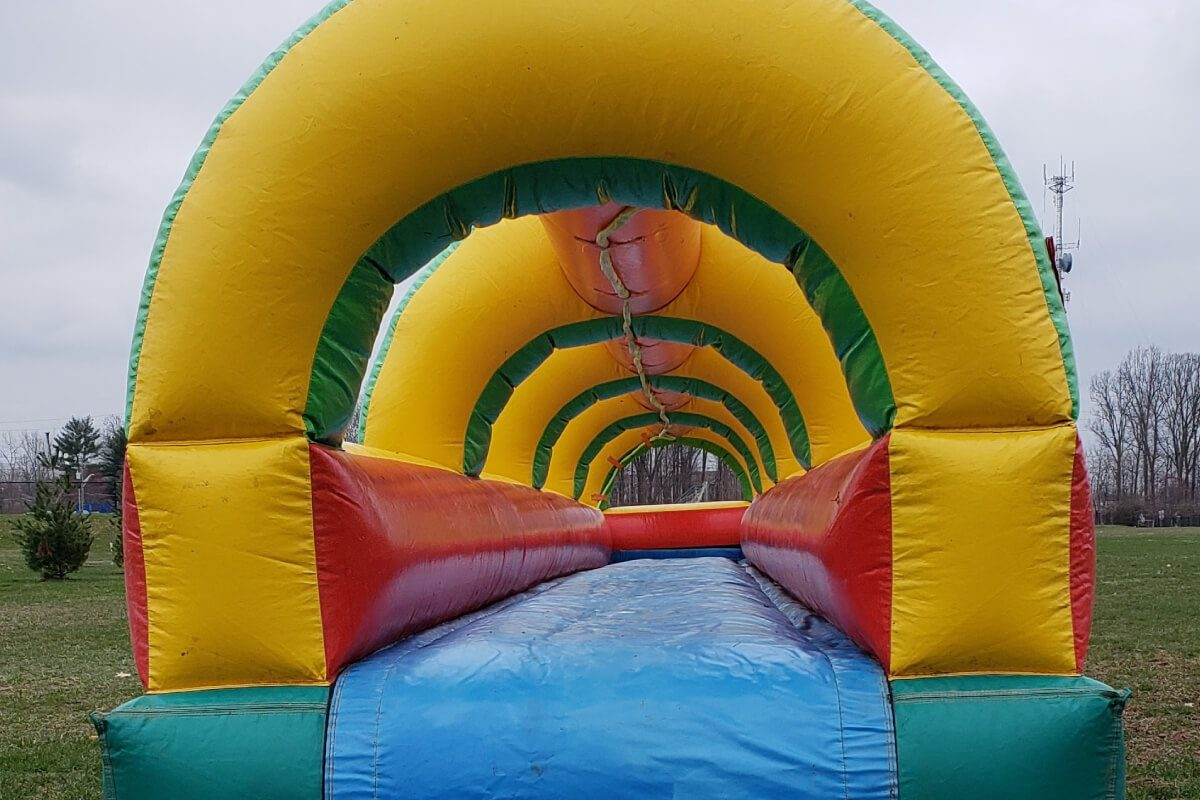 long slip n slide bounce house set up in indianapolis park